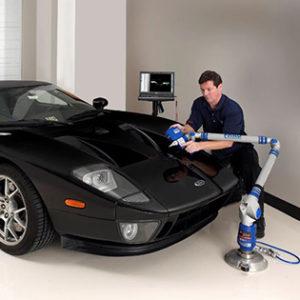 An employee is 3d scanning a car.